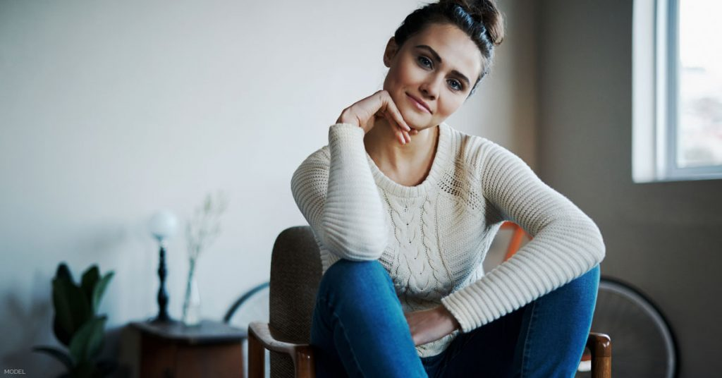 Woman sitting contemplating a Mommy Makeover procedure in Kalispell